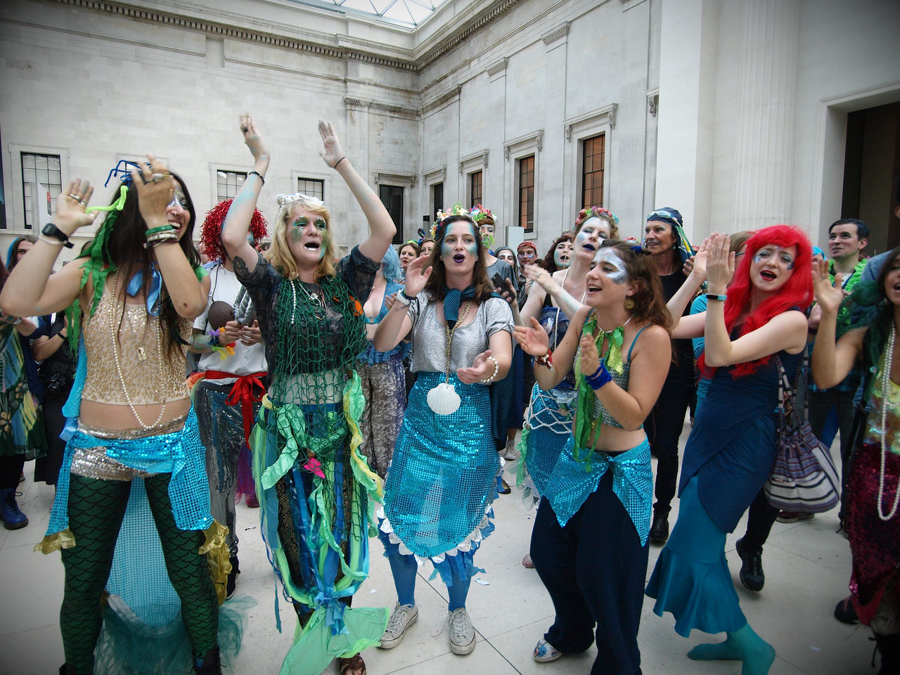 celebration, arms raised, fun, costume, real people, day, front view, lifestyles, leisure activity, dancing, happiness, enjoyment, building exterior, looking at camera, togetherness, outdoors, architecture, portrait, friendship, young women, young adult, people