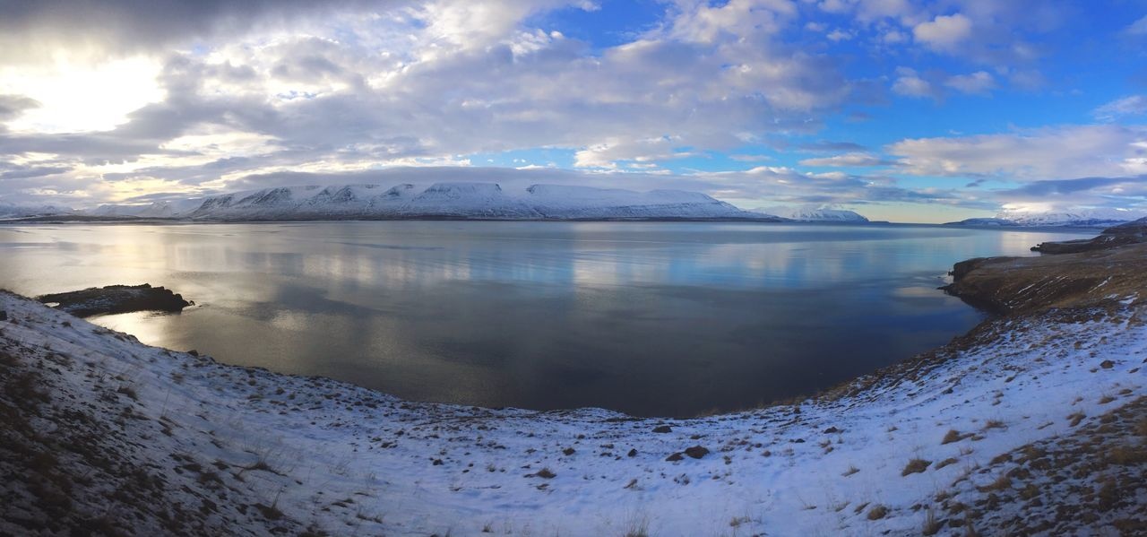 sky, winter, mountain, snow, nature, beauty in nature, cloud - sky, cold temperature, scenics, water, tranquil scene, ice, tranquility, reflection, outdoors, no people, lake, landscape, day, iceberg