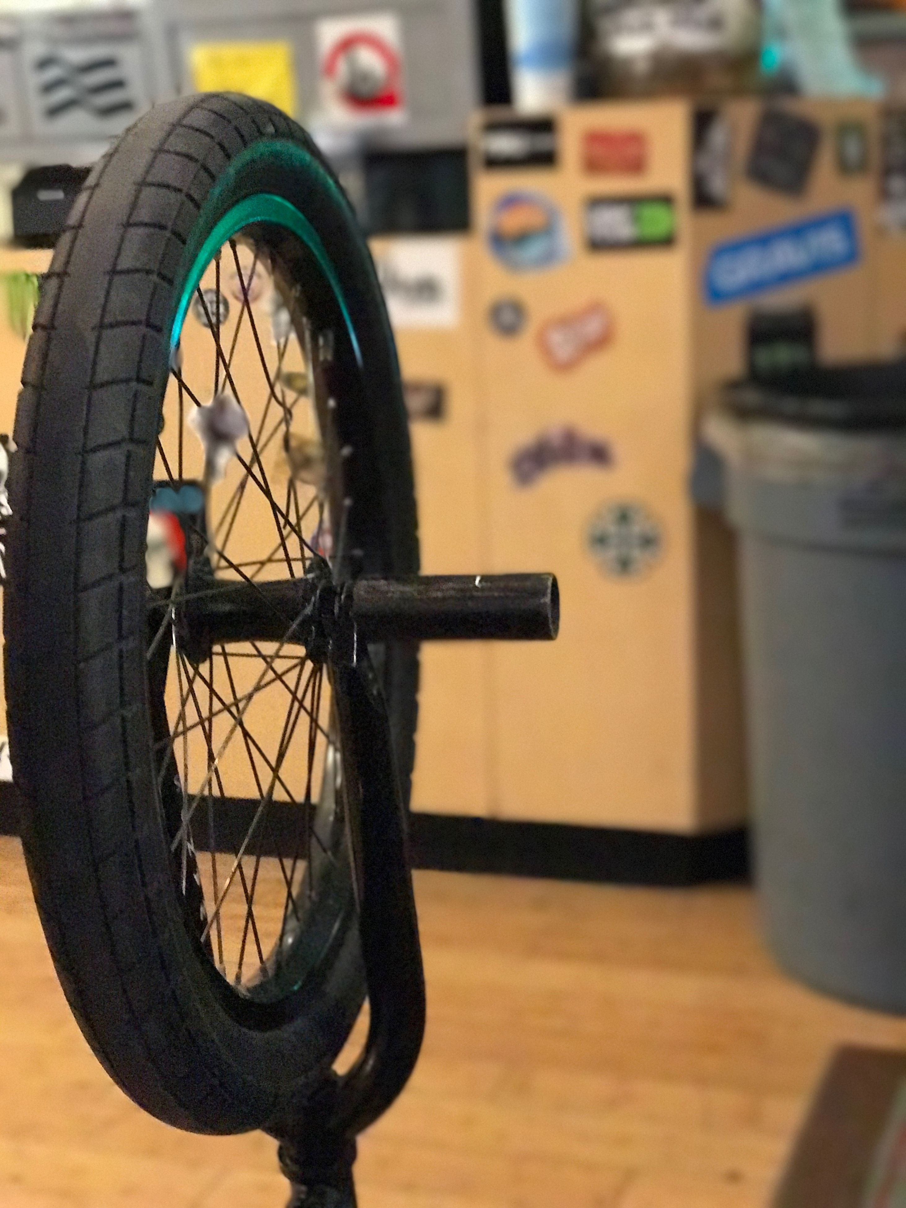 bicycle, wheel, business finance and industry, mode of transport, vehicle part, indoors, no people, pedal, tire, close-up, workshop, day
