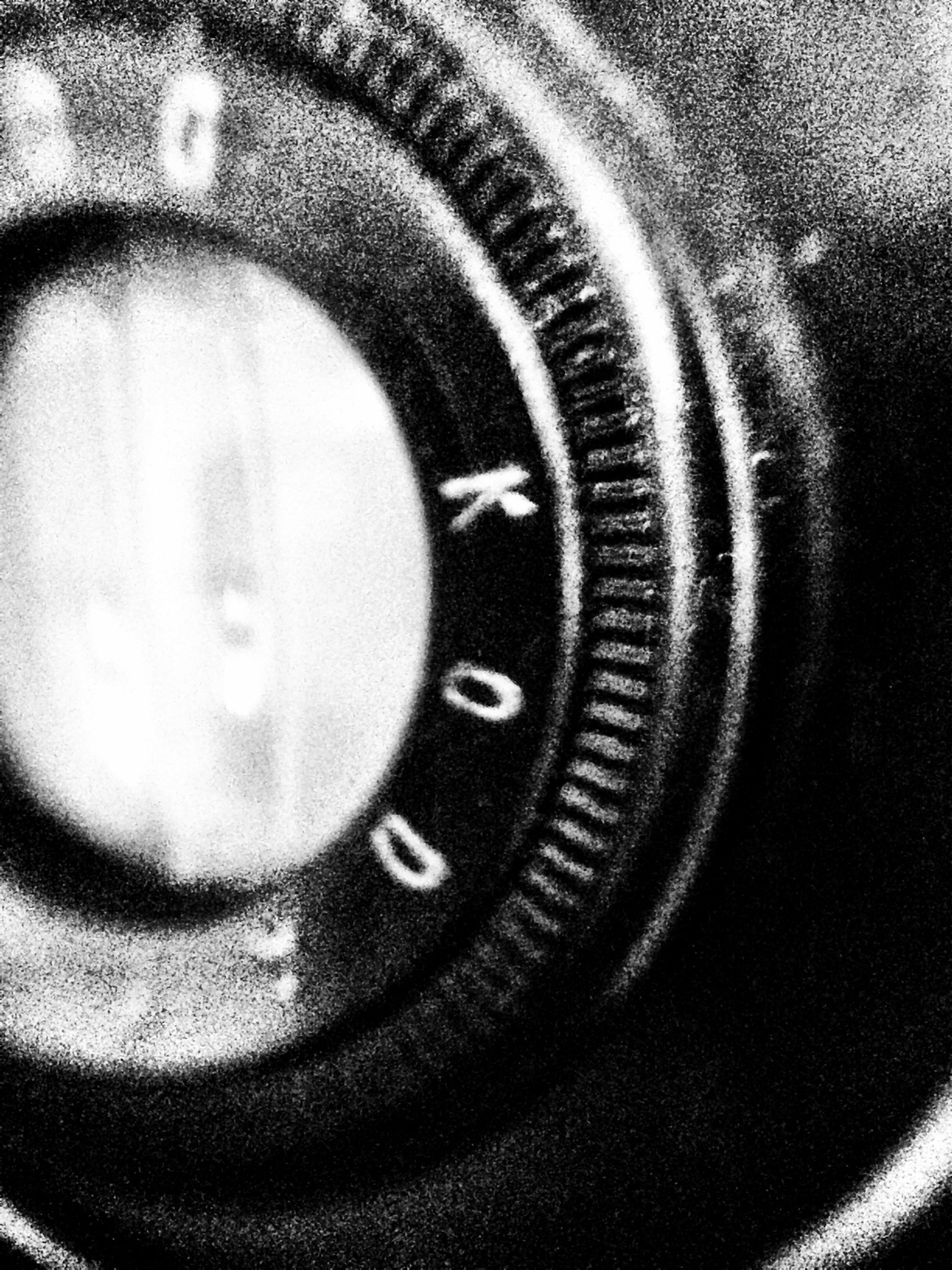 indoors, close-up, circle, part of, technology, reflection, selective focus, focus on foreground, still life, single object, photography themes, high angle view, time, camera - photographic equipment, cropped, human eye, lens - optical instrument