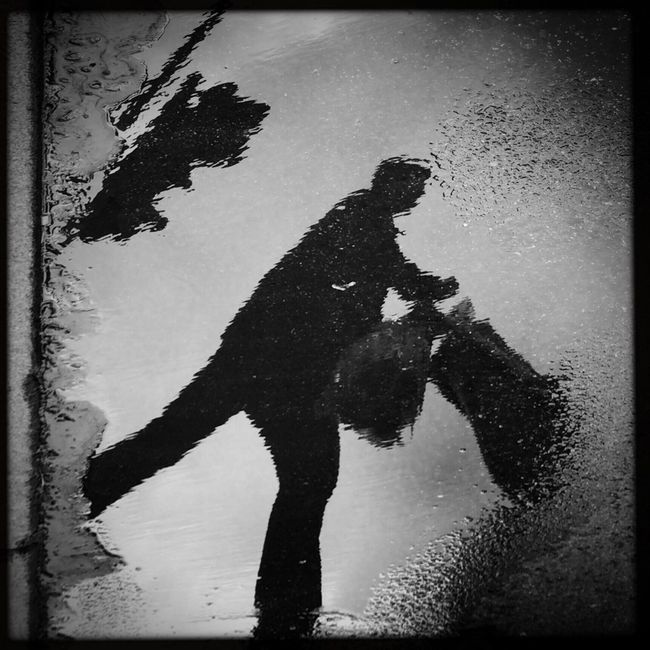 EverchangingBerlin The Passenger Puddleography Streetphoto_bw