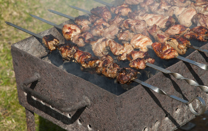 Grilling marinated meat on a brazier Barbeque BBQ Brazier Cooking Delicious Gourmet Grill Heat Hot Lamb Marinated Meal Meat Metal Picnic Pork Preparation  Roast Rustic Shashlik Skewer Smoke Steak Yummy Market Reviewers' Top Picks