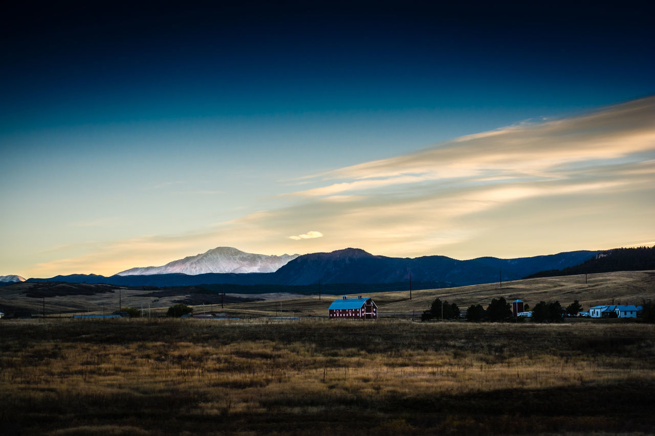 mountain, sunset, nature, scenics, sky, landscape, field, beauty in nature, tranquil scene, mountain range, blue, tranquility, outdoors, no people, day