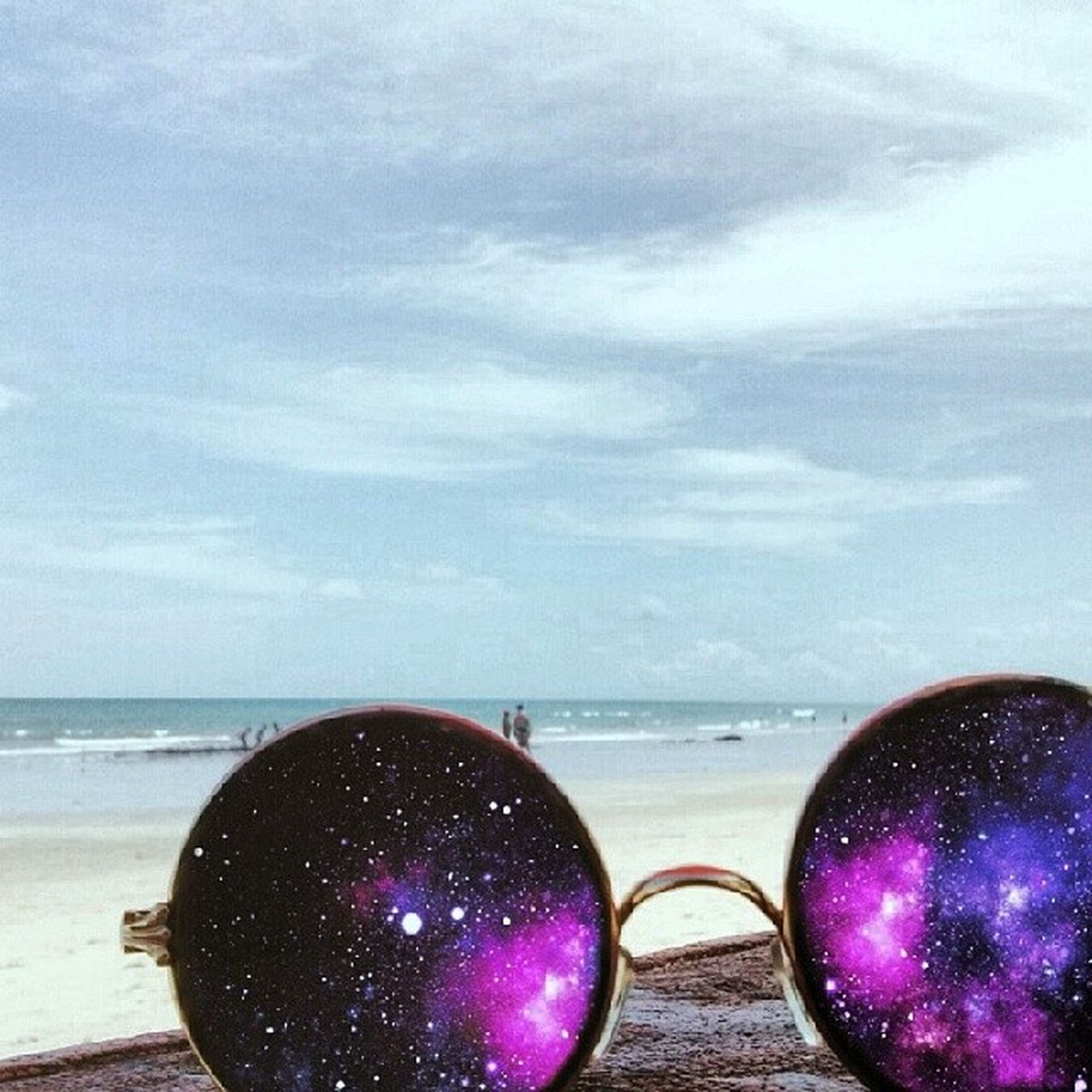 sea, sky, water, horizon over water, food and drink, cloud - sky, red, close-up, beauty in nature, no people, scenics, nature, beach, freshness, ball, circle, tranquil scene, outdoors, fruit, tranquility