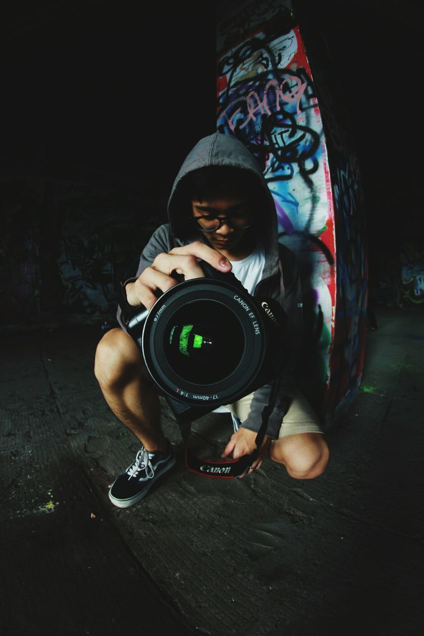 real people, camera - photographic equipment, childhood, full length, playing, photography themes, photographer, one person, technology, boys, photographing, outdoors, lifestyles, digital single-lens reflex camera, day, people