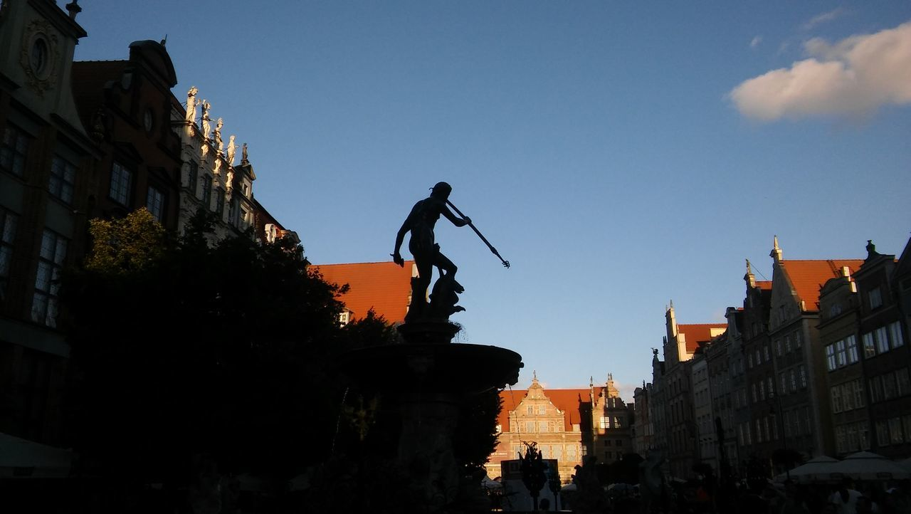 statue, sculpture, architecture, human representation, building exterior, art and craft, built structure, male likeness, low angle view, silhouette, history, outdoors, day, sky, travel destinations, real people, city