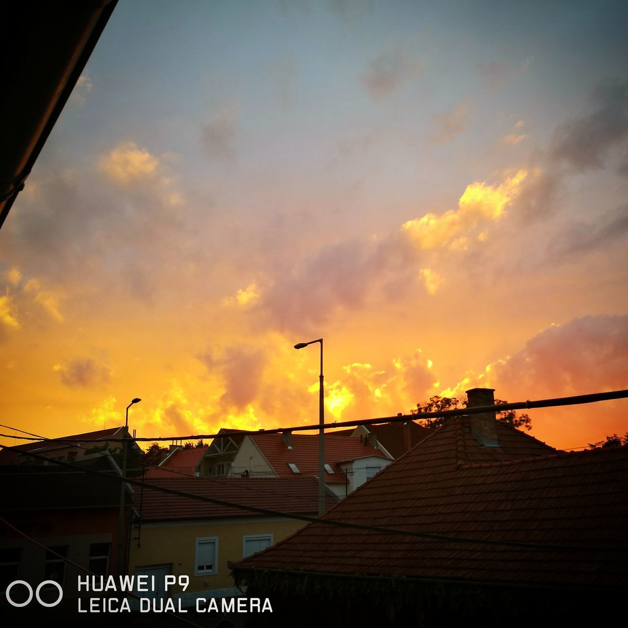 sunset, architecture, built structure, building exterior, communication, low angle view, sky, cloud - sky, no people, roof, outdoors, television aerial, nature, day