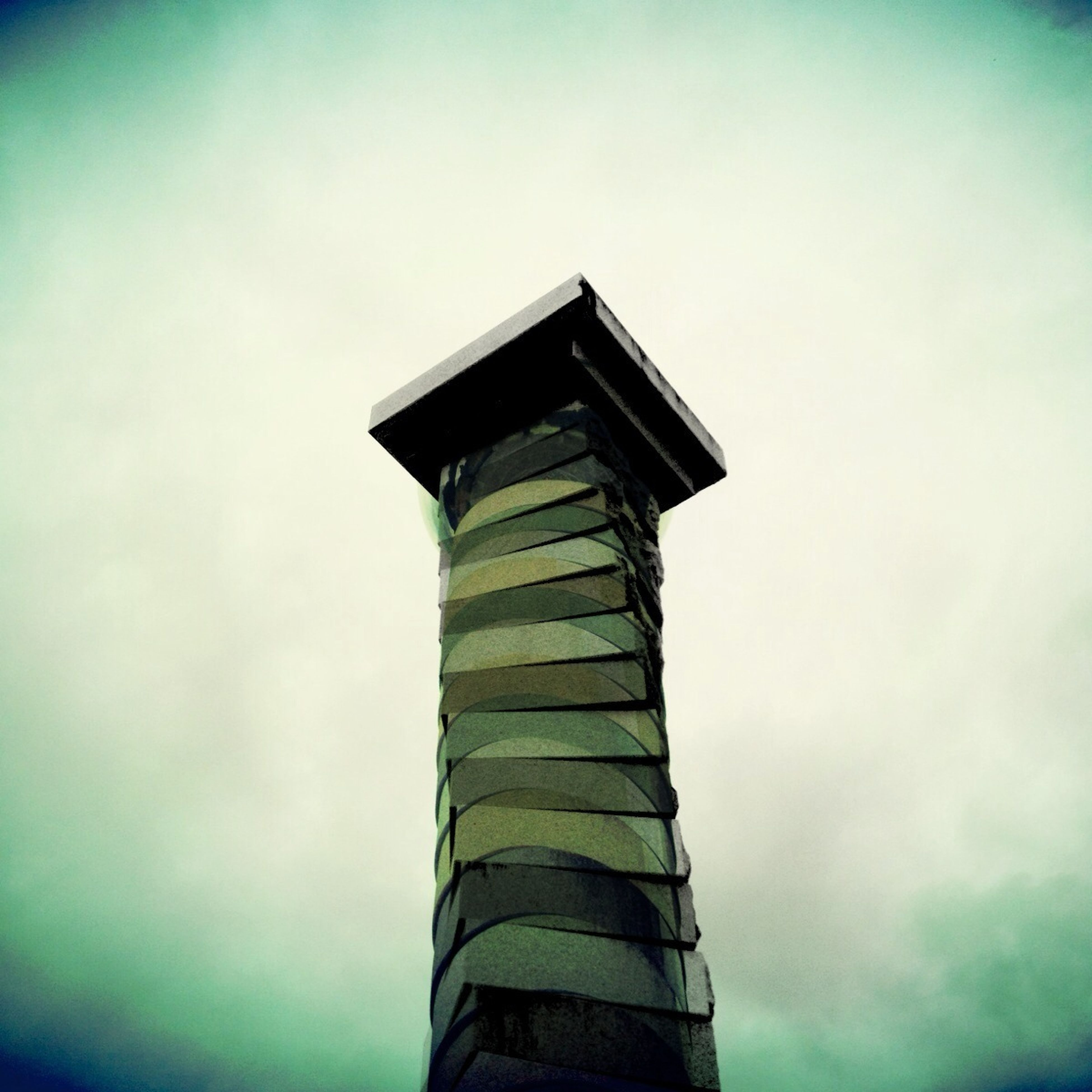 low angle view, sky, built structure, architecture, cloud - sky, building exterior, cloud, day, outdoors, high section, no people, architectural column, auto post production filter, column, blue, tower, cloudy, history, old, dusk