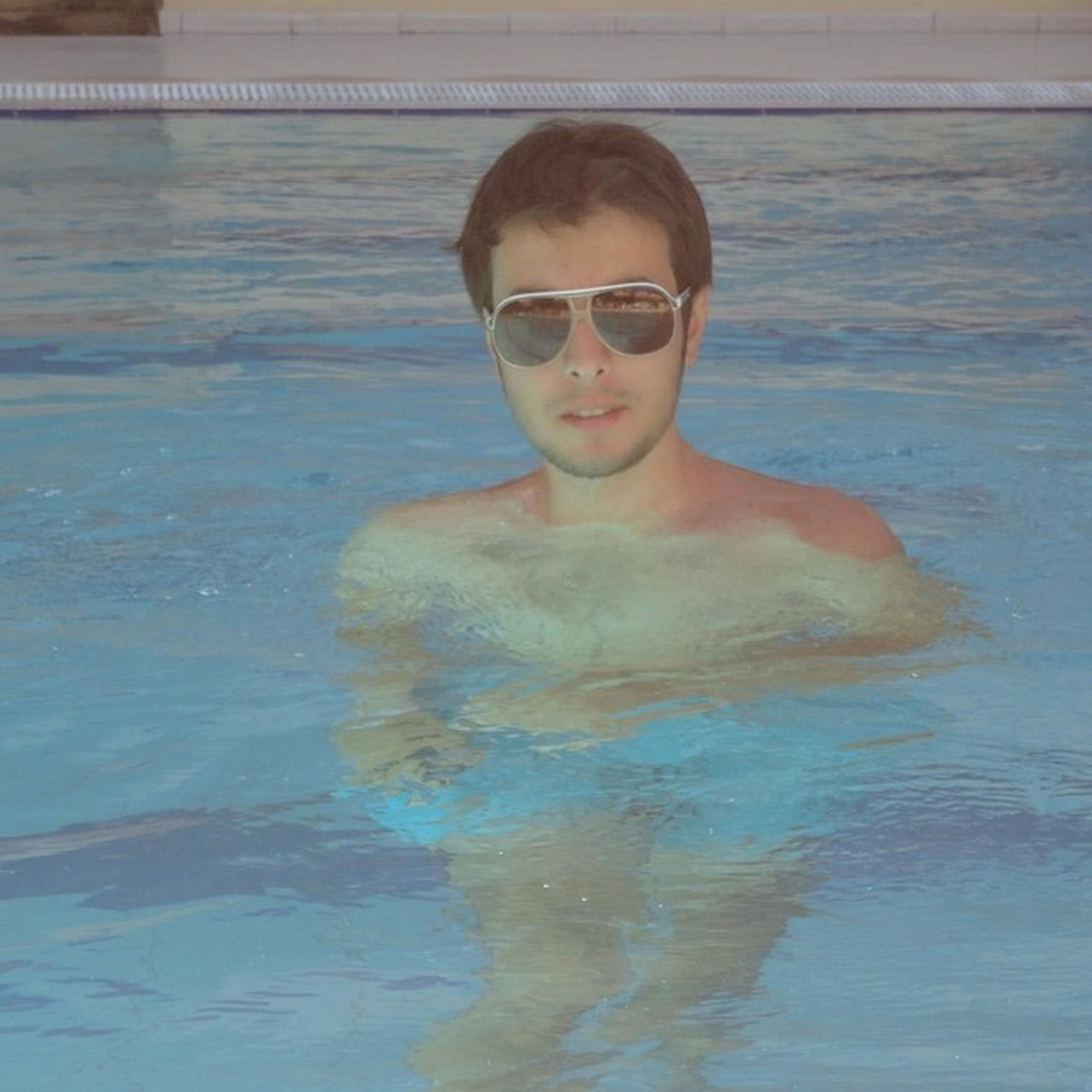 person, portrait, water, lifestyles, looking at camera, leisure activity, young adult, front view, smiling, casual clothing, waist up, swimming pool, happiness, young men, sunglasses, headshot, standing, refreshment