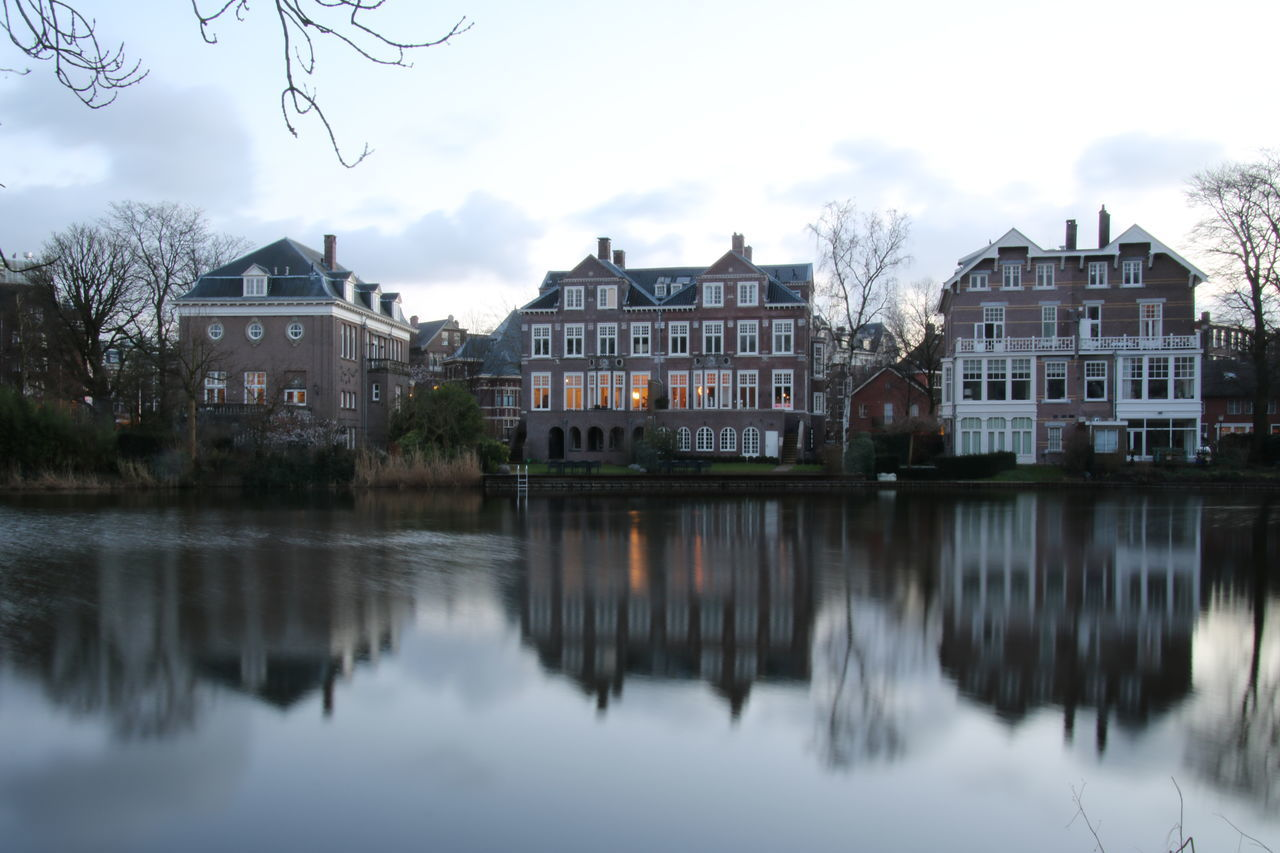 architecture, building exterior, built structure, house, reflection, sky, water, residential building, waterfront, no people, tree, outdoors, day, nature