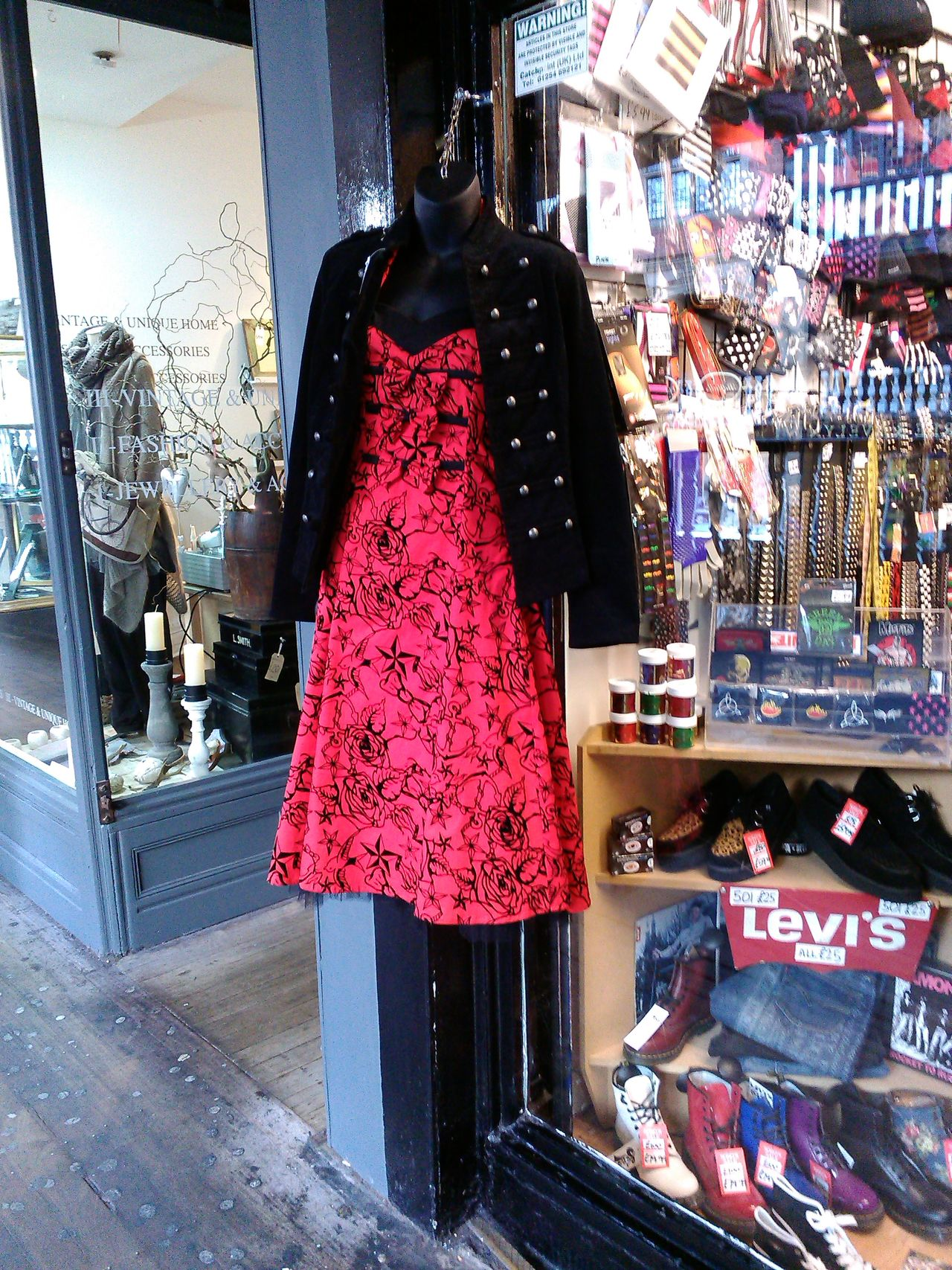 Red dress. Hanging red dress. Garment. Fashion garment. Store. Exterior. Outside. Casual Clothing Dress Dress Hanging Fashion Front View Full Length Hanging Out Jacket Lifestyles Red Shop Shop Window Standing Vintage Clothing. Window Display. Young Women