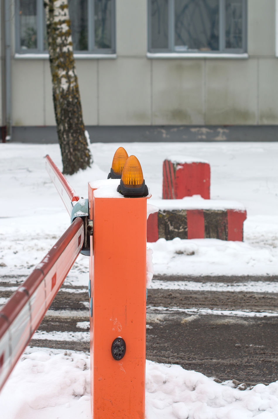 Winter road with tyre print and red entrance barrier pole Barrier Business City Cold Temperature Day Fire Hydrant Frozen Lamp Nature No People Outdoors Pass Permit Red Signal Snow Snowing Transportation Winter EyeEmNewHere