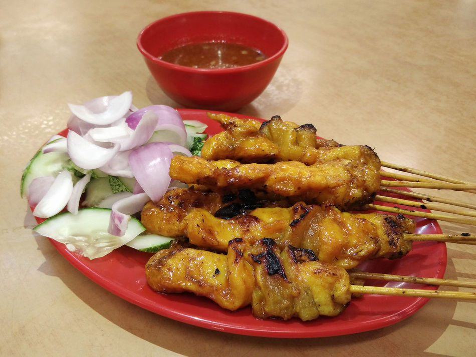 Chicken Satay, Malaysian Cuisine Asian Food BBQ Chicken Close-up Cucumber Cuisine Famous Place Food Freshness Grilled Chicken Indoors  Malaysian Food Meat No People Onion Rings Plate Ready-to-eat Satay Sauce Serving Size Slices Table Tasty