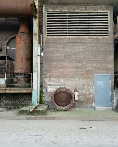 In love with the colors Architecture No People Building Exterior Full Frame Vintage Facades Pipeline Steelwork Factory Steel Lines Faded Rusty Adapted To The City Architecture Industry Built Structure Urban Geometry Workers Abondoned Heart Love Light Colors Door Old Buildings