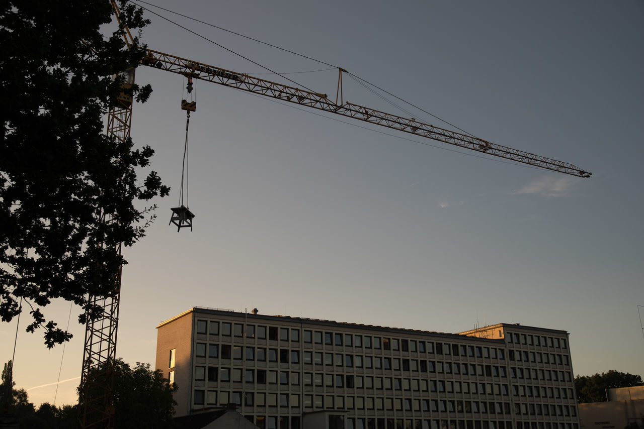 Apartment Architecture Blue Building Building Exterior Built Structure City Clear Sky Cloud Construction Construction Site Crane Crane - Construction Machinery Day Development Growth High Section Low Angle View No People Outdoors Progress Sky Tax Office Tree