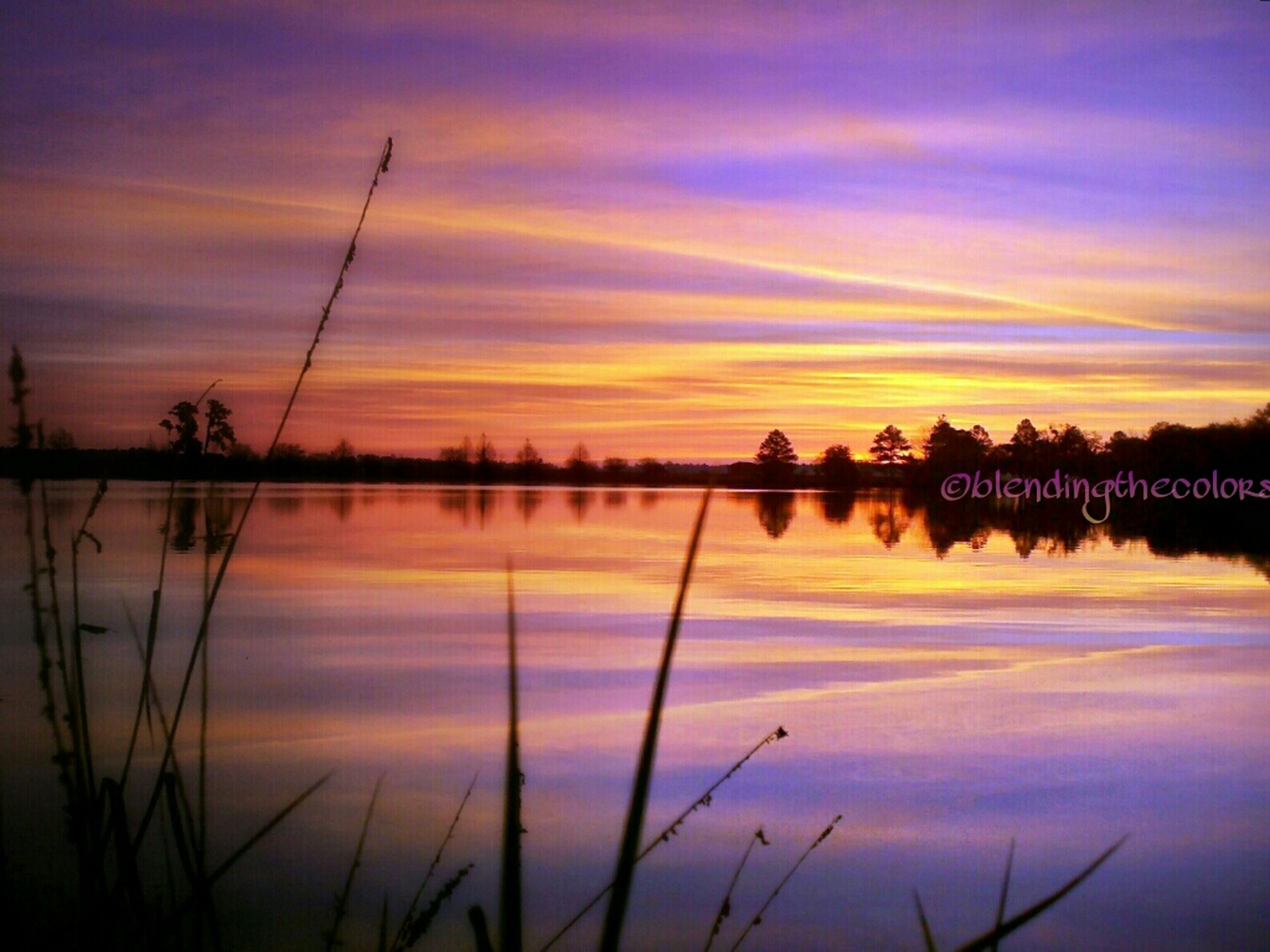 sunset, reflection, water, silhouette, lake, sky, tranquil scene, scenics, tranquility, beauty in nature, orange color, idyllic, nature, cloud - sky, standing water, cloud, dusk, calm, dramatic sky, majestic