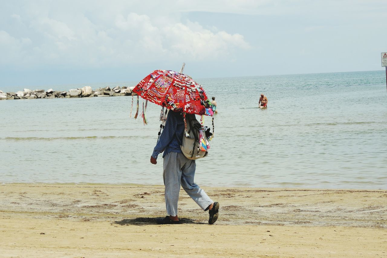 Italy Feel The Journey Funnyumbrella Umbrella Redumbrella Beachphotography Beach Life Sansalvo Italia People Photography People Watching People Walking  Working Hard Ambulant Showcase June People And Places