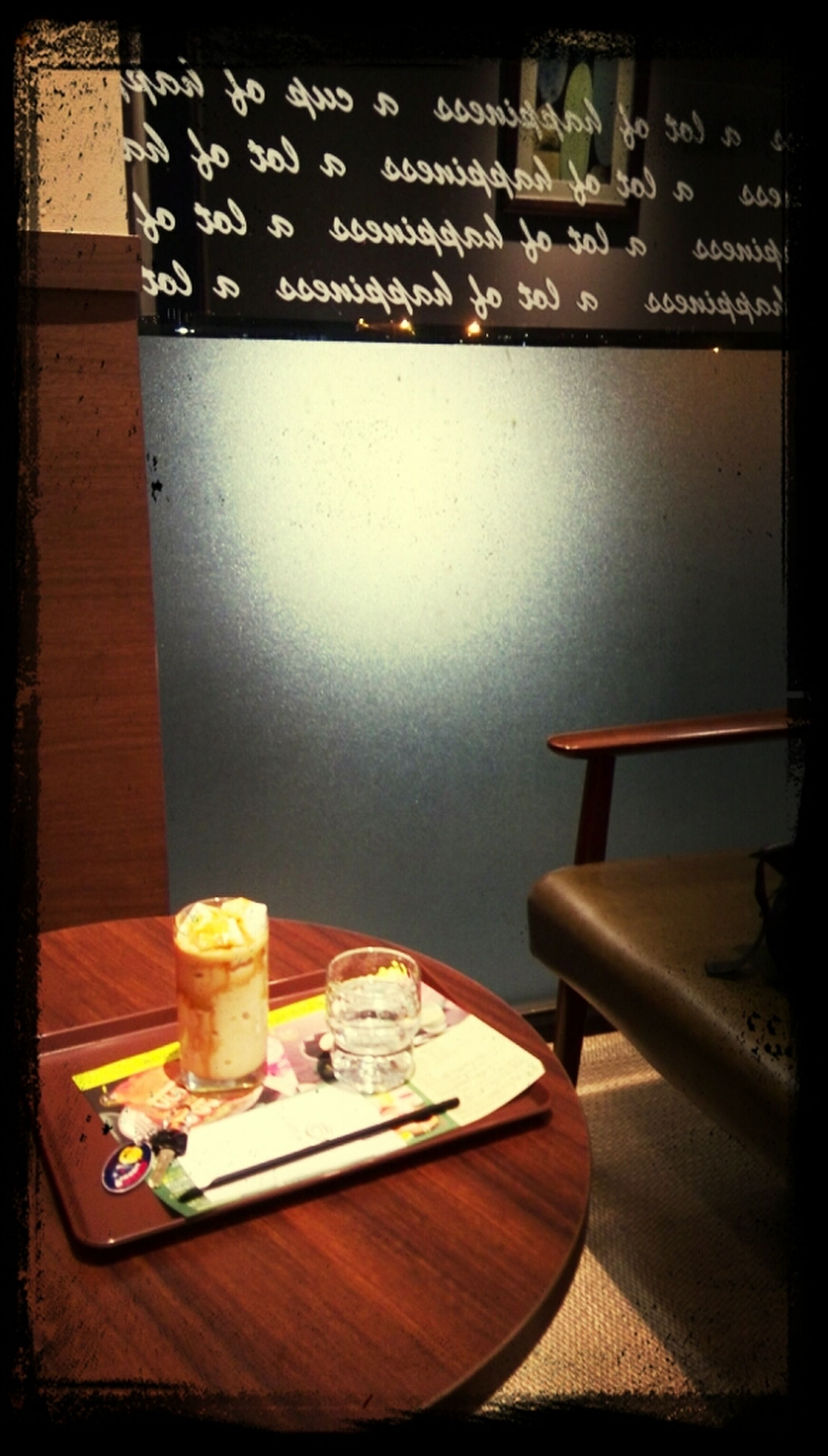 table, indoors, chair, absence, transfer print, auto post production filter, high angle view, empty, still life, restaurant, wood - material, home interior, book, no people, relaxation, day, plate, food and drink, place setting, tablecloth
