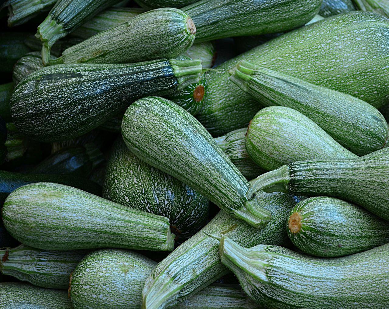 Full Frame Shot Of Fresh Zucchinis At Market Stall