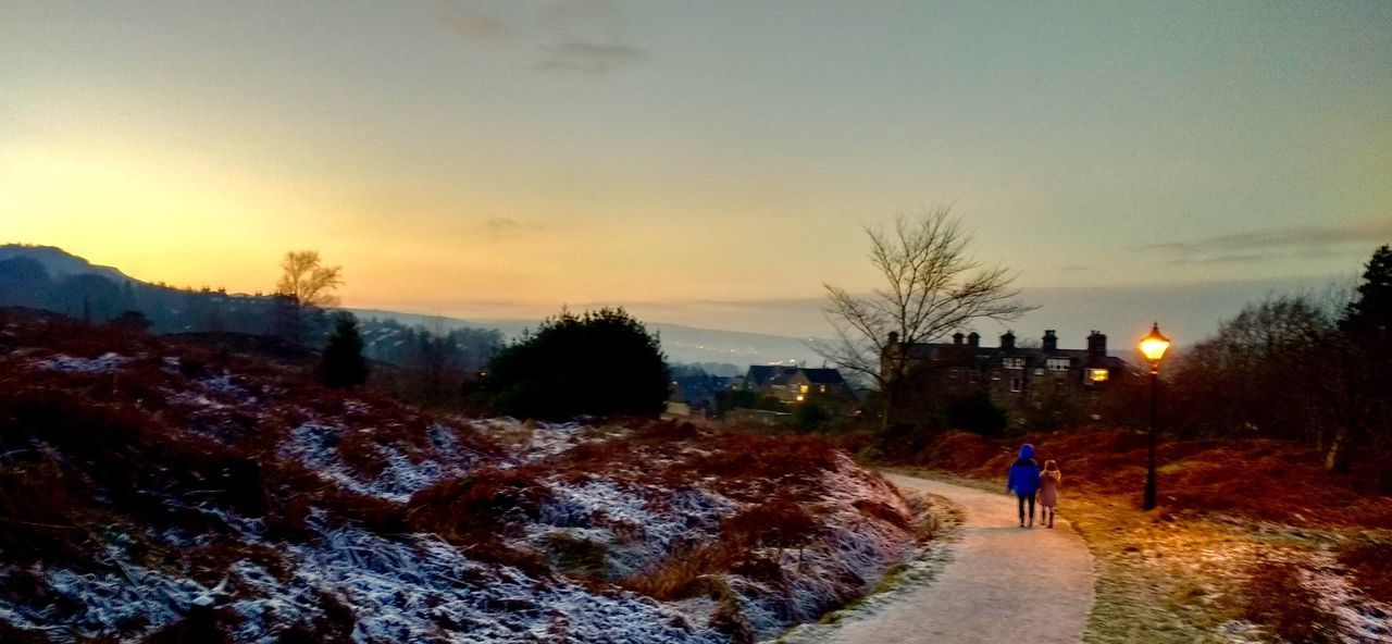 Ilkley Tarn & Ilkley moor at sunset. Sunset Tree Sky Winter Building Exterior Real People Outdoors Built Structure Snow Architecture Nature Beauty In Nature Men One Person People Day Ilkley Moor Ilkley Tarn