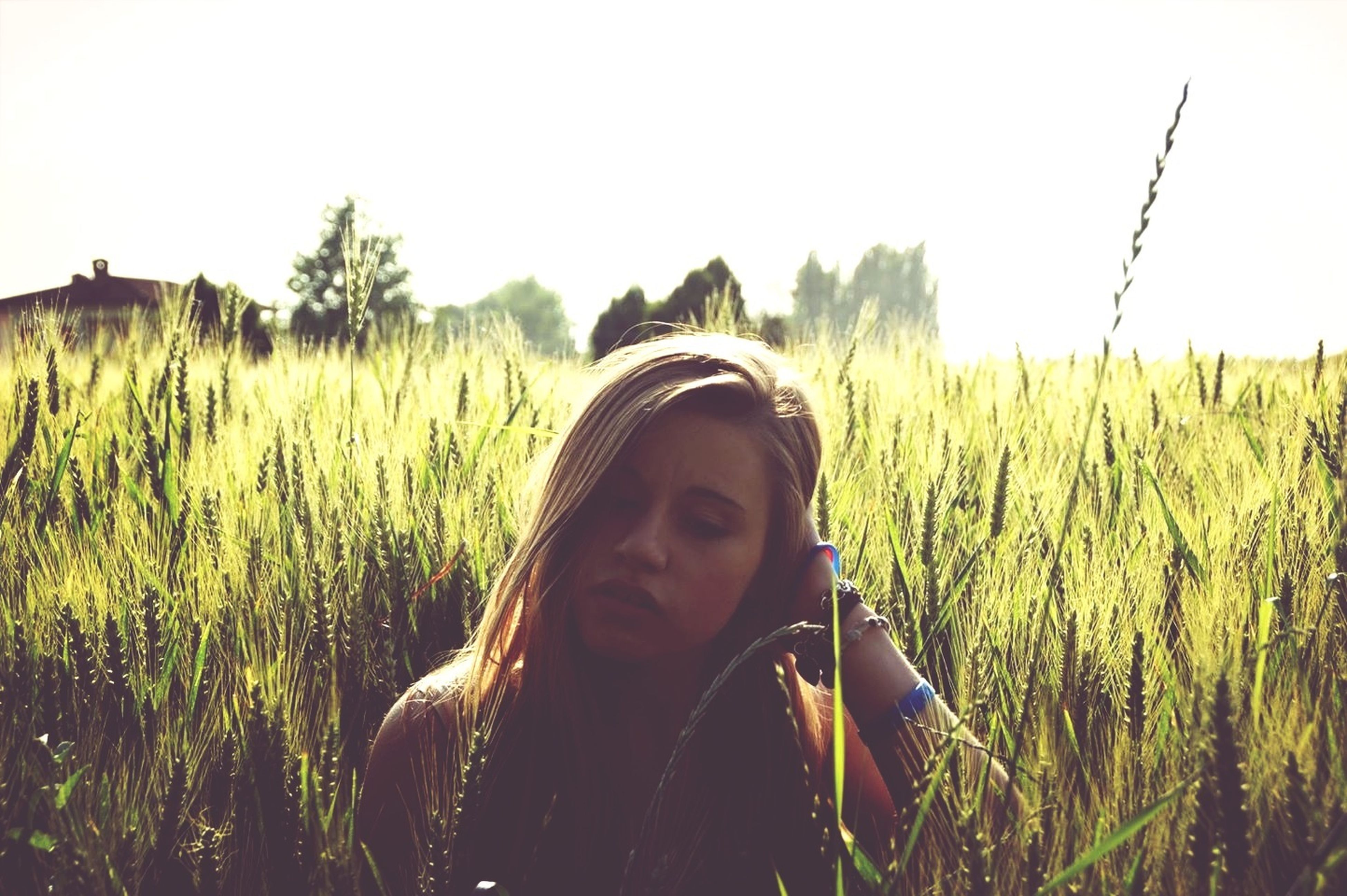 grass, field, clear sky, agriculture, lifestyles, rural scene, plant, farm, crop, growth, leisure activity, young adult, landscape, nature, standing, casual clothing, grassy, copy space