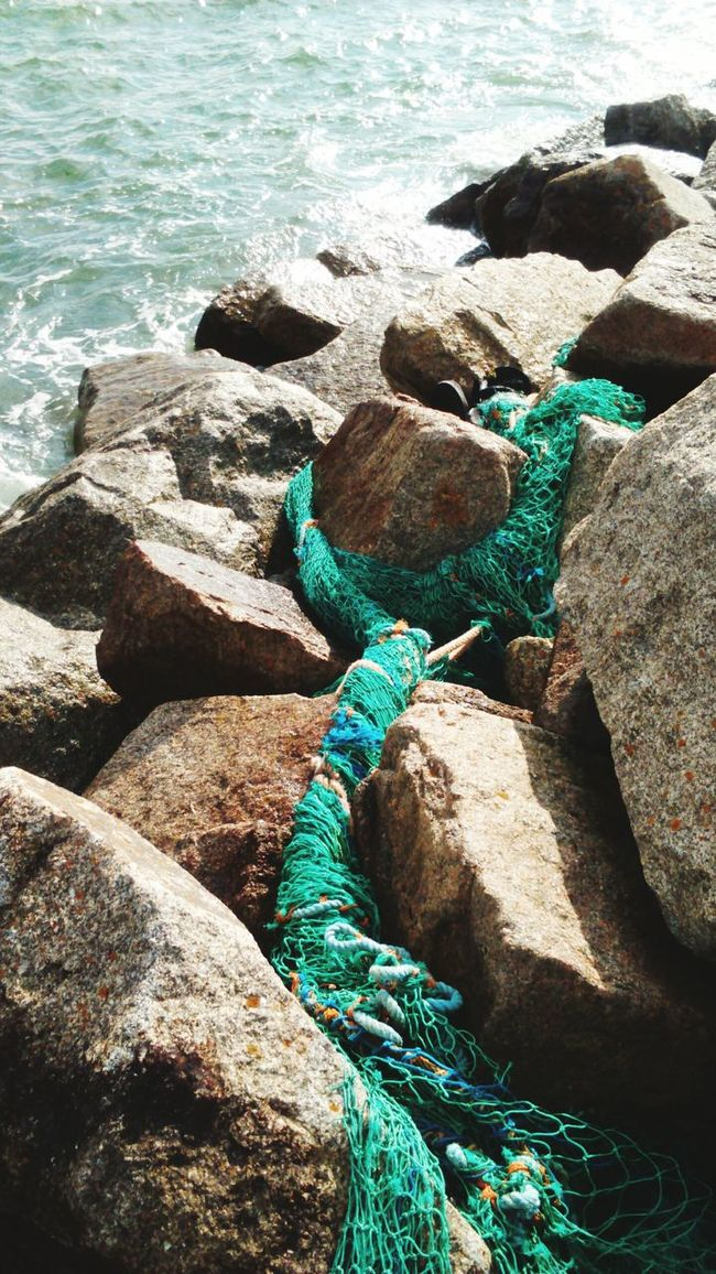 There are some in the fishing industry who don't show any regard for the environment sadly this is the result abandond nets and pollution. Penzance  Cornwall Polution Is All Around The World Eco Poluted Earth Shore Stone - Object Water Multi Colored Coastal Life Coastal Walks Random Eye4photography  Photo Of The Day EyeEm Best Shots From My Polnt Of View Fishing Industry Abandoned Fishing Travel Photography Coastal Landscape Coastal Nature Reserve Ocean Photography Obsolete