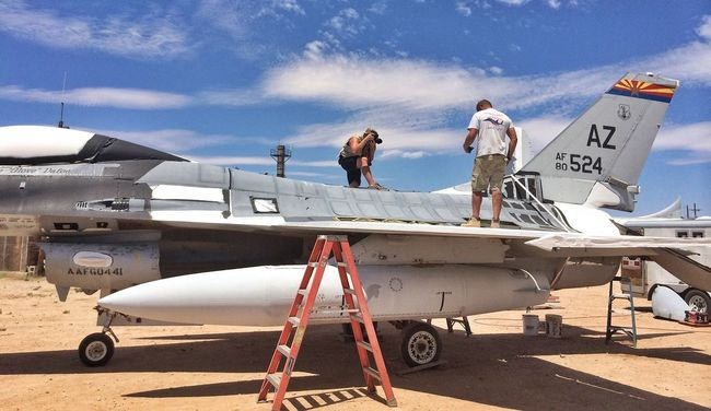Fun day in the sun. Today's photoshoot is in sunny Tucson, on top of an Air Force F-16. Advertising imagery never stops, no matter the location or temperature. USAF F16 Photoshoot Advertising