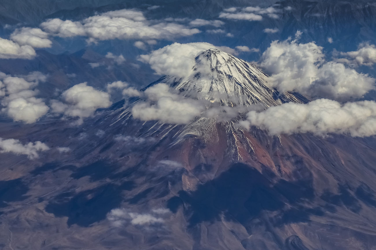 Mt Damavand volcano in Iran is the highest peak in the Middle East at 5670m high. It is located to the North East of Tehran and south of the Caspian Sea. Love Life, Love Photography Active Volcano Beauty In Nature Caspian Sea Cloud - Sky Damavand Desert Geology Ice Iran Middle East Mountain Mountains Nature No People Physical Geography Rock Scenics Smoke - Physical Structure Snow Tehran Travel Volcanic  Volcanic Crater Volcanic Landscape Volcano