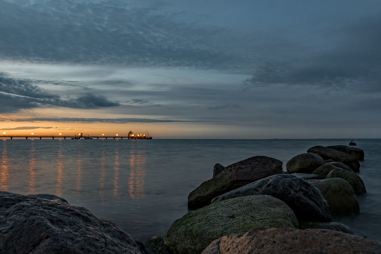 rocks and water Architecture Baltic Sea Beach Beauty In Nature Built Structure Cloud - Sky Day Dusk Early Morning Blues Grömitz Strand Horizon Over Water Nature No People Outdoors Rock - Object Rocks And Water Scenics Schleswig-Holstein Sea Sky Sunset Tranquil Scene Tranquility Water