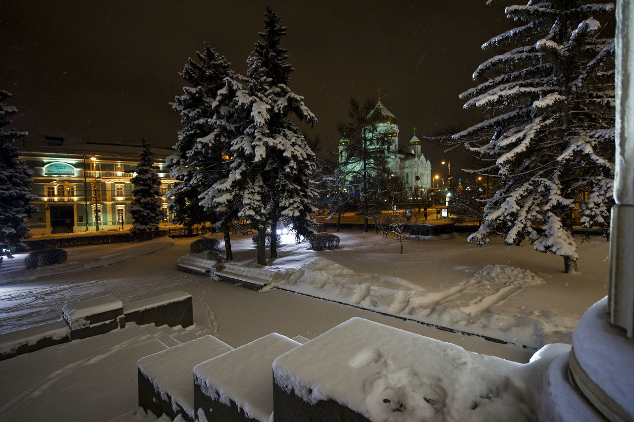 Snow Covered Field By Buildings Seen From Pushkin State Museum Of Fine Arts