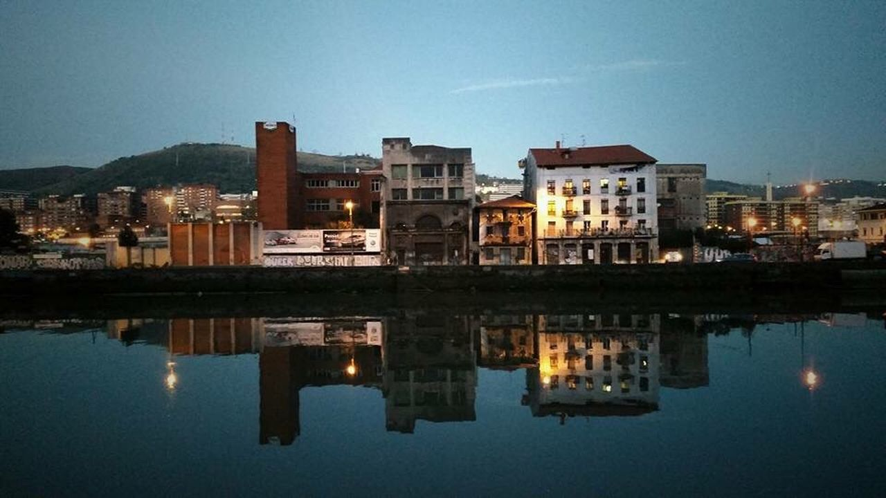 Reflection Water Illuminated City Building Exterior Architecture Waterfront Built Structure Sky Outdoors No People Night Nature Horizontal Bilbaolovers Bilbao Bilbaoarchitecture Bilbao - Lights And Colors Bilbaostreets Bilbaoshare