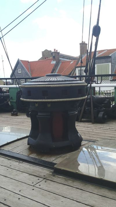 Nautical Vessel Historic Sailing Ship Frigate Naval Ship Warship Deck Canon Gun Gunports Capstan Bulwark Bollards Ships Rigging Ropes And Lines Buildings Rooftops Quayside Harbour Outdoors Blue Sky Cloud - Sky Wooden Ship Transportation Mode Of Transport