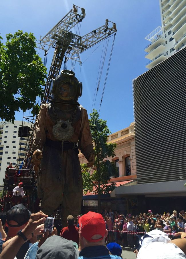 PERTH, AUSTRALIA-FEBRUARY 14, 2015: Journey of the Giants, Giant Marionette Diver and Crane, public International Arts Festival Art Art Event Australia Australianshepherd Belts And Pulleys City Cityscape Crane Crowds Culture Diver Festival Giant Human International Journey Marionette People Puppeteers Walking Winchester Wooden