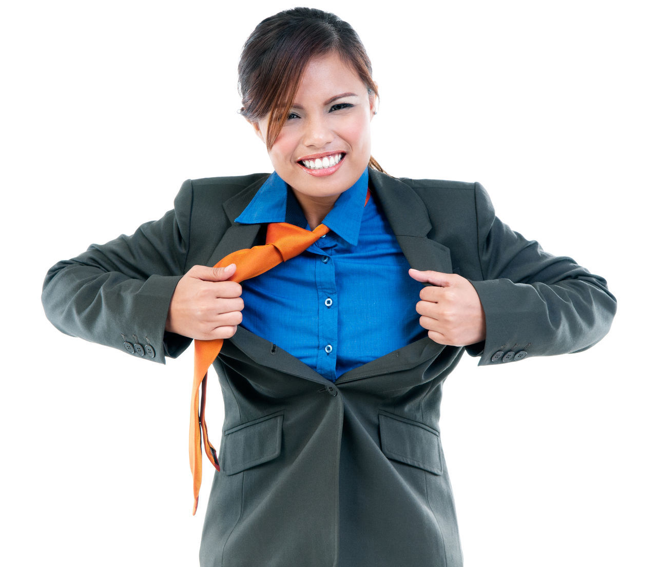 Portrait of a young businesswoman pulling her suit with her hands like a superhero Asian  Brave Businesswear Concept Confident  Corporate Courageous Female Front View Girl Power Happy Heroine Hispanic One Person People Power Powerful Woman Pulling Suit Apart Smile Strong Superhero Pose Waist Up White Background Young Adult Young Woman