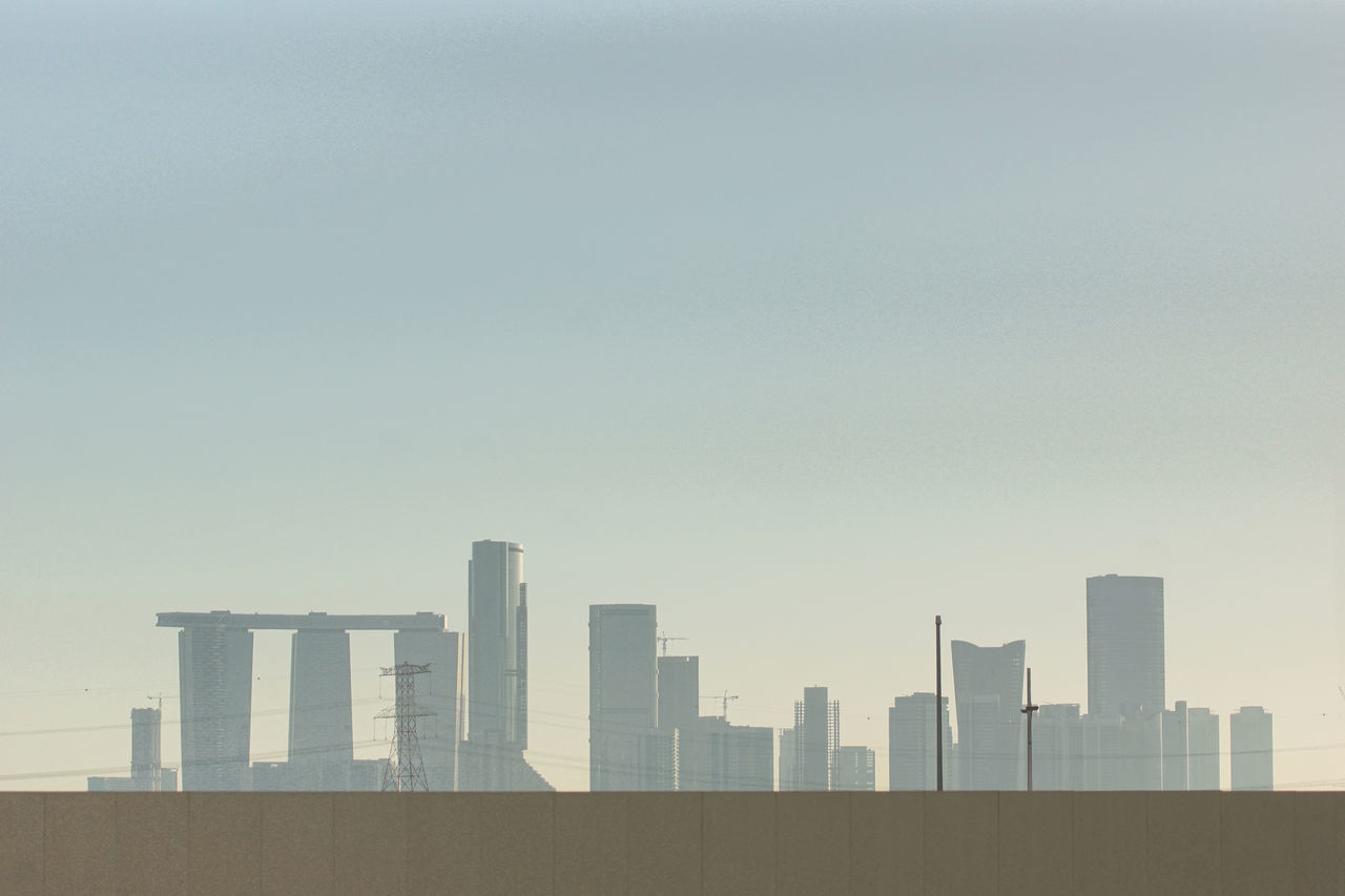 Modern Stonehenge Abstract Abu Dhabi Arabian Architecture Building Exterior Built Structure City Cityscape Day Fence Haze Hazy  Modern Modern Architecture No People Outdoors Power Line  Shapes Shapes And Forms Silhouette Skyscraper Sunlight Urban Urban Geometry Urban Skyline