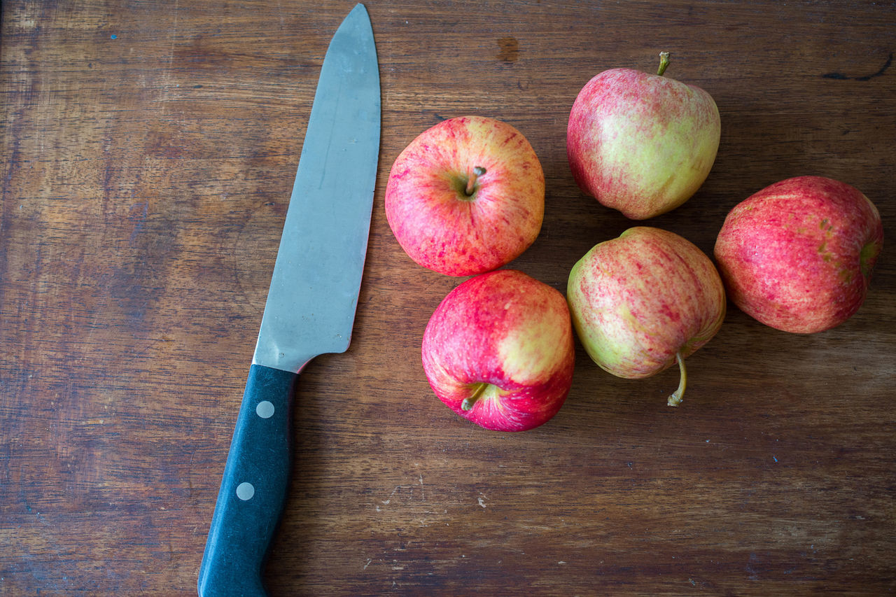 Apple Apples Background Blush Close-up Cutting Cutting Board Dark Wood Day Food Freshness Fruit Harvest Harvesting Healthy Eating Indoors  Knife No People Red Fruit Rosy Rosy Apple Slicing Table Wood - Material Wooden