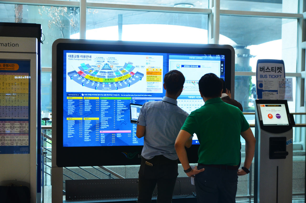 Men combine forces to the monitor Doubt EyeEmNewHere Korea Lost Machine Map Tourist Adult Airport Computer Monitor Confused Day Device Screen Doubtful Incheon International Airport Indoors  Indoors  Men People Real People Rear View Standing Technology Touch Screen Wander