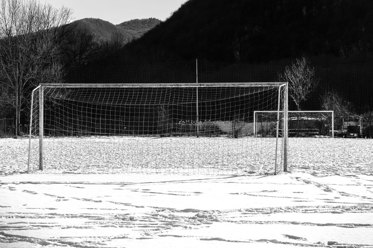 Day Football Goal Goal Post Nature Netting No People Outdoors Sand Snow Soccer Goal Sport Tree White