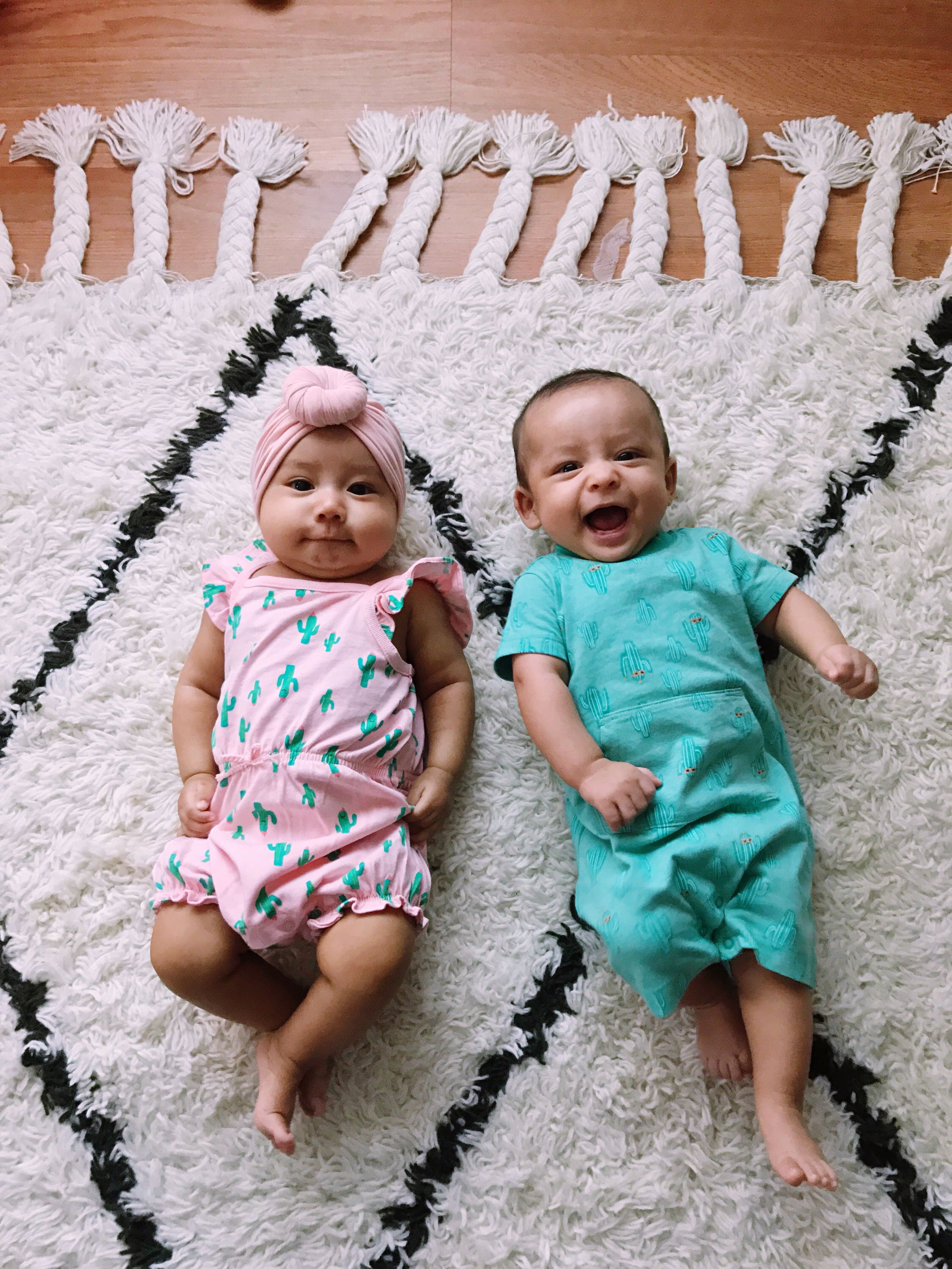baby, full length, baby clothing, innocence, high angle view, females, babyhood, lying down, bonding, babies only, people, day, happiness, childhood, outdoors, young women, smiling, togetherness, adult