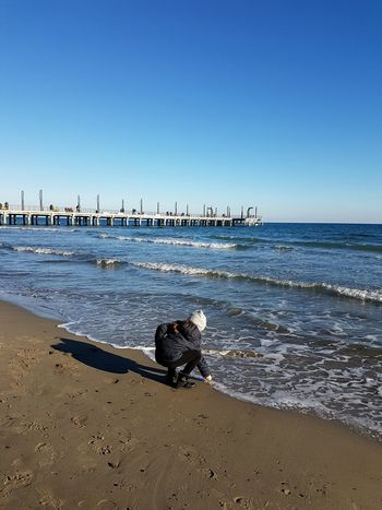 Sea Beach Horizon Over Water Water Clear Sky Sky Sunlight Nature Outdoors Beauty In Nature Tranquility Sand Scenics Day Wave Alassio Liguria,Italy Relaxing Moments Littlegirl Winterbeach Looking For Shells EyeEmNewHere Long Goodbye Live For The Story