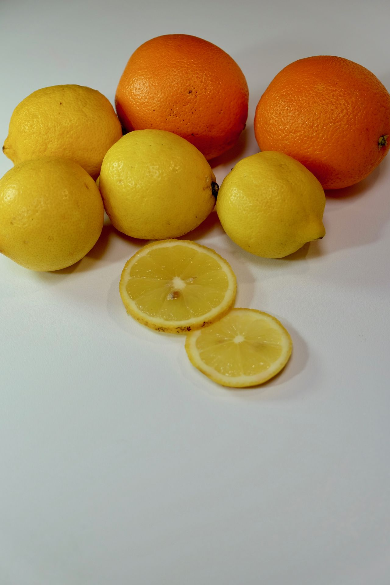 Citrus Fruit Close-up Day Food Food And Drink Food And Drink Food Photography Food Porn Food Porn Awards Foodie Foods Freshness Fruit Gray Background Healthy Eating Indoors  Lemon No People SLICE Sour Taste Squeezing Studio Shot Table White Background Yellow