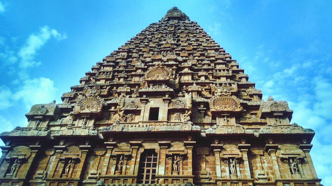 Architecture Travel Destinations Built Structure Religion Building Exterior History Sky Tourism Travel Cloud - Sky Low Angle View Place Of Worship No People Blue Day Spirituality Ancient Civilization Tanjore Big Temple Monument Archaeology India