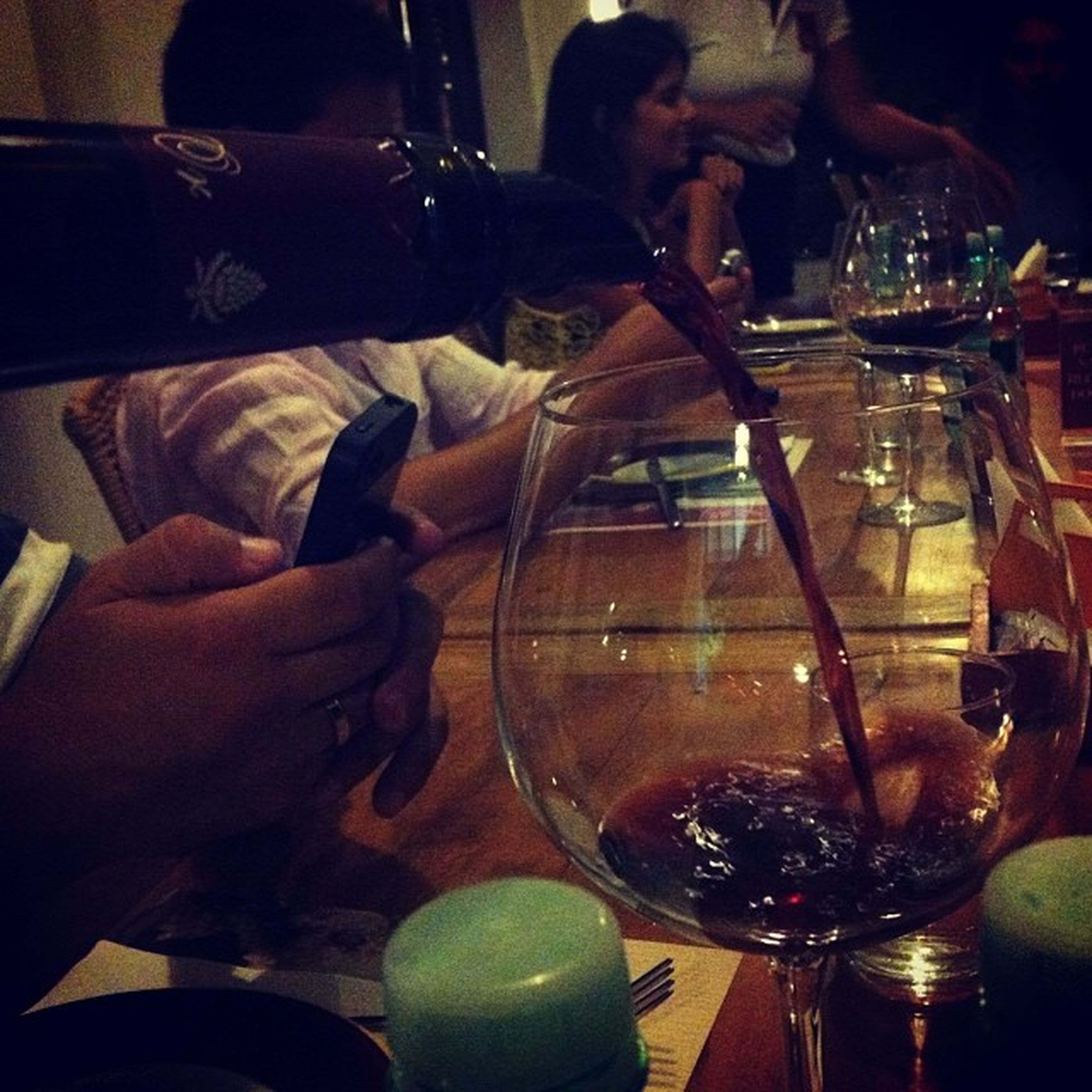 indoors, drinking glass, food and drink, drink, glass - material, table, alcohol, wineglass, refreshment, transparent, wine, reflection, restaurant, close-up, freshness, red wine, glass, wine glass