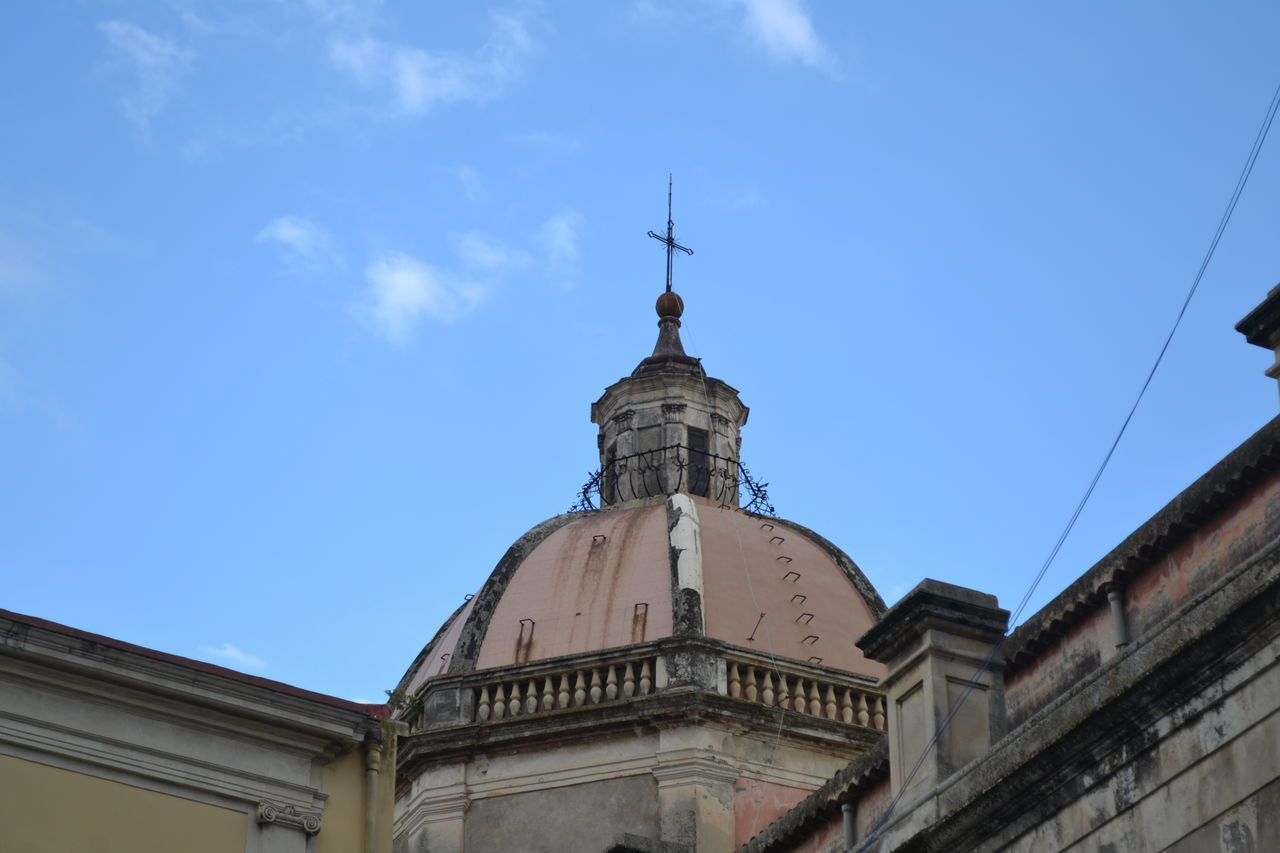 Low Angle View Of Cathedral Against Blue Sky