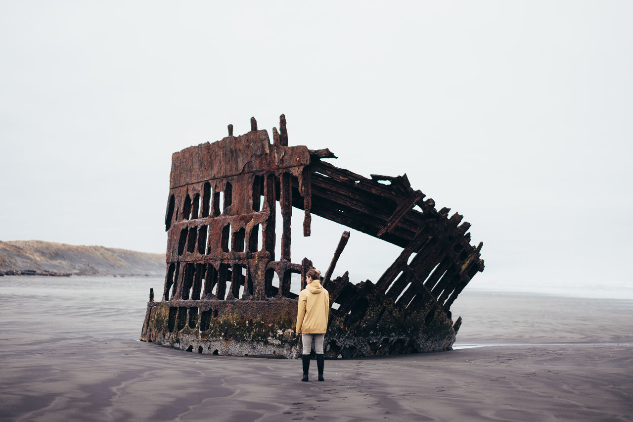 Husk Adults Only People Nature Beach Outdoors Only Women Tranquility Coast Oregon Travel Destinations The Great Outdoors - 2017 EyeEm Awards The Portraitist - 2017 EyeEm Awards Power In Nature Beauty In Nature Minimalism Rear View One Woman Only PNW Scenics Landscape Sea Morning Tranquil Scene Peter Iredale Shipwreck