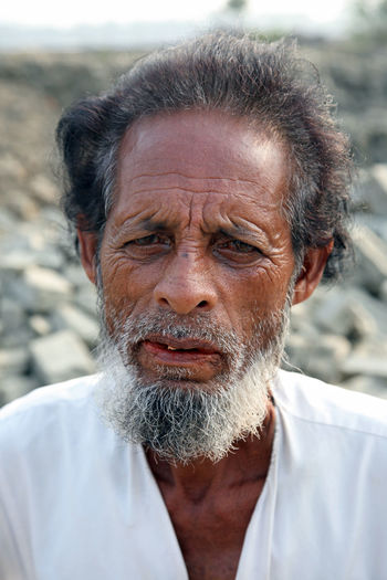 Portrait of a day laborer January 14, 2009 in Kumrokhali, West Bengal, India. Adult ASIA Face HEAD Headshot Hindu Human Face India Kumrokhali Laborer Look Looking At Camera Male Men Person Poor  Portrait Poverty Rural Street Village West Bengal Work Working