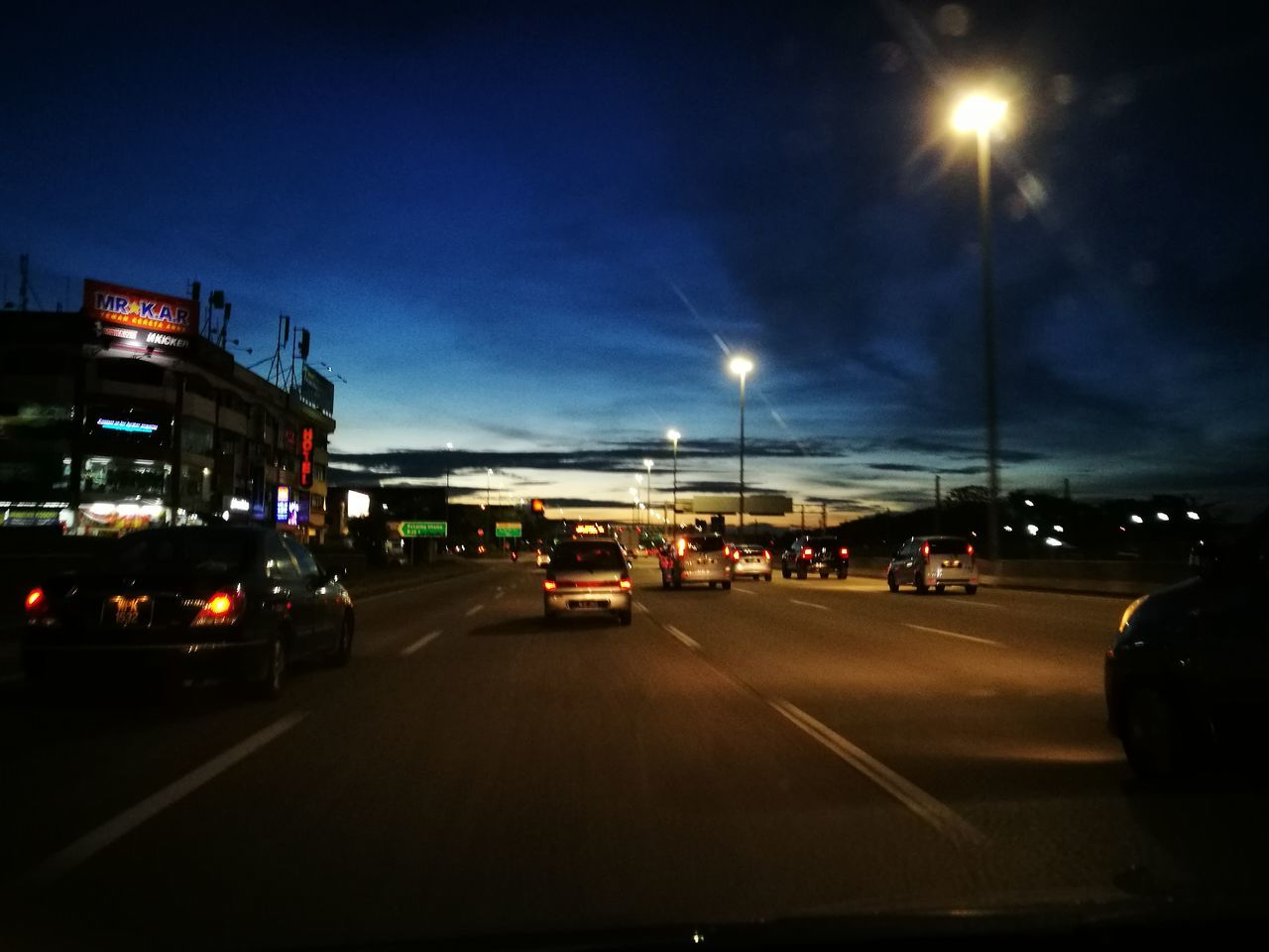 Nofilter Architecture Mode Of Transport Land Vehicle Road Building Exterior Transportation Traffic Dusk Outdoors Gas Station No People Night Illuminated City Sky Car