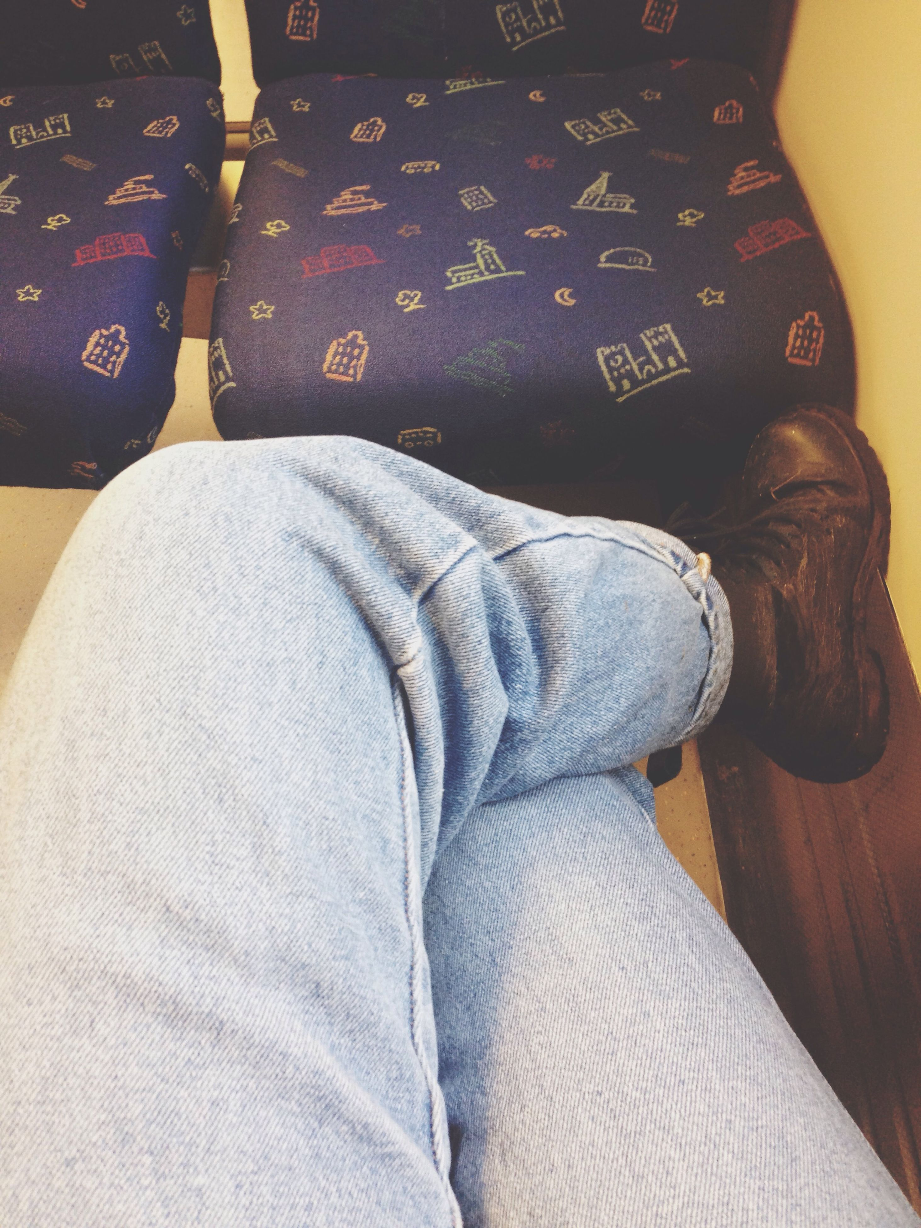 indoors, person, low section, jeans, shoe, human foot, lifestyles, casual clothing, high angle view, relaxation, footwear, personal perspective, close-up, bed, fashion, leisure activity, denim