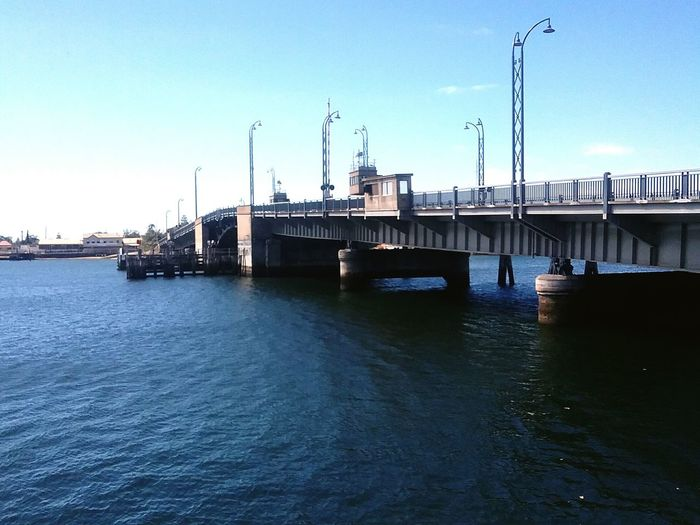 Bridge View Bridge - Man Made Structure Bridge Over Water Blue Sky Background Water Lamp Posts On Bridge Opening Bridge
