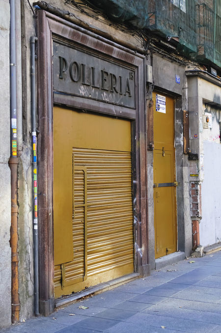 Closed doors of an old chicken roastery in th centre of Madrid. Architecture Bilbao Building Exterior Built Structure Chicken Closed Closed Door Day Door Editorial  Façade Historic No People Old Outdoors Roastery Text Tourism Travel